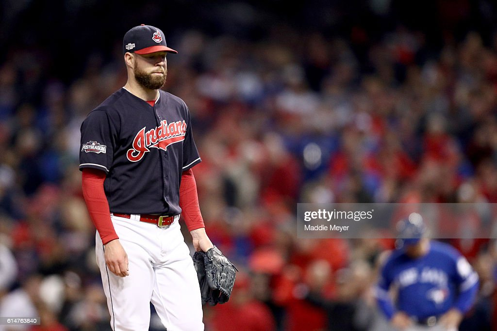 Corey Kluber #28 of the Cleveland Indians walks off the mound after being relieved in the seventh inning against the Toronto Blue Jays during game one of the American League Championship Series at Progressive Field on October 14, 2016 in Cleveland, Ohio.