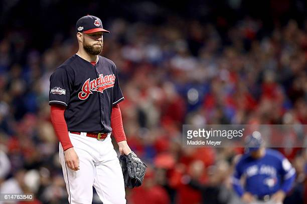Corey Kluber of the Cleveland Indians walks off the mound after being relieved in the seventh inning against the Toronto Blue Jays during game one of...