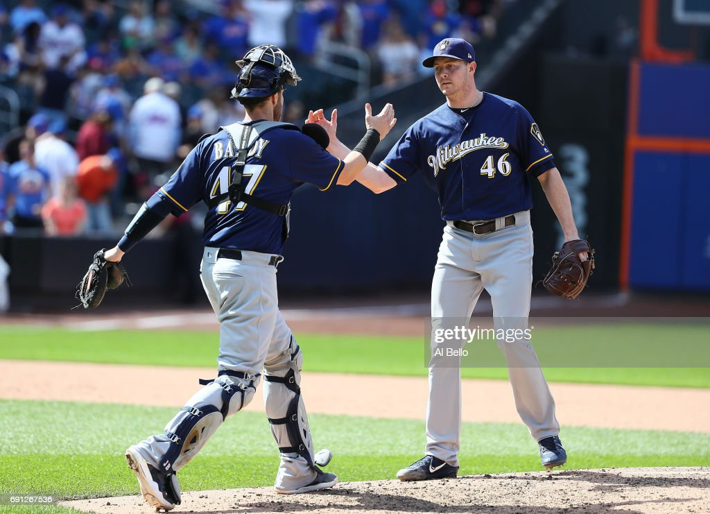Corey Knebel #46 and Jett Bandy #47 of the Milwaukee Brewers celebrate a 2-1 win against the New York Mets at Citi Field on June 1, 2017 in New York City.