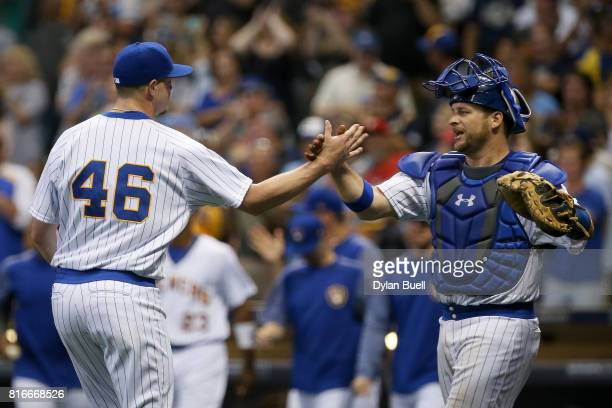 Corey Knebel and Stephen Vogt of the Milwaukee Brewers celebrate after beating the Philadelphia Phillies 32 at Miller Park on July 15 2017 in...
