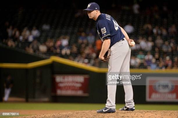 Corey Knebel of the Milwaukee Brewers delivers a pitch in the MLB game against the Arizona Diamondbacks at Chase Field on June 9 2017 in Phoenix...