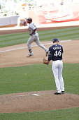 Corey Knebel of the Milwaukee Brewers stands on the pitching mound after giving up a home run to Torrii Hunter of the Minnesota Twins in the ninth...