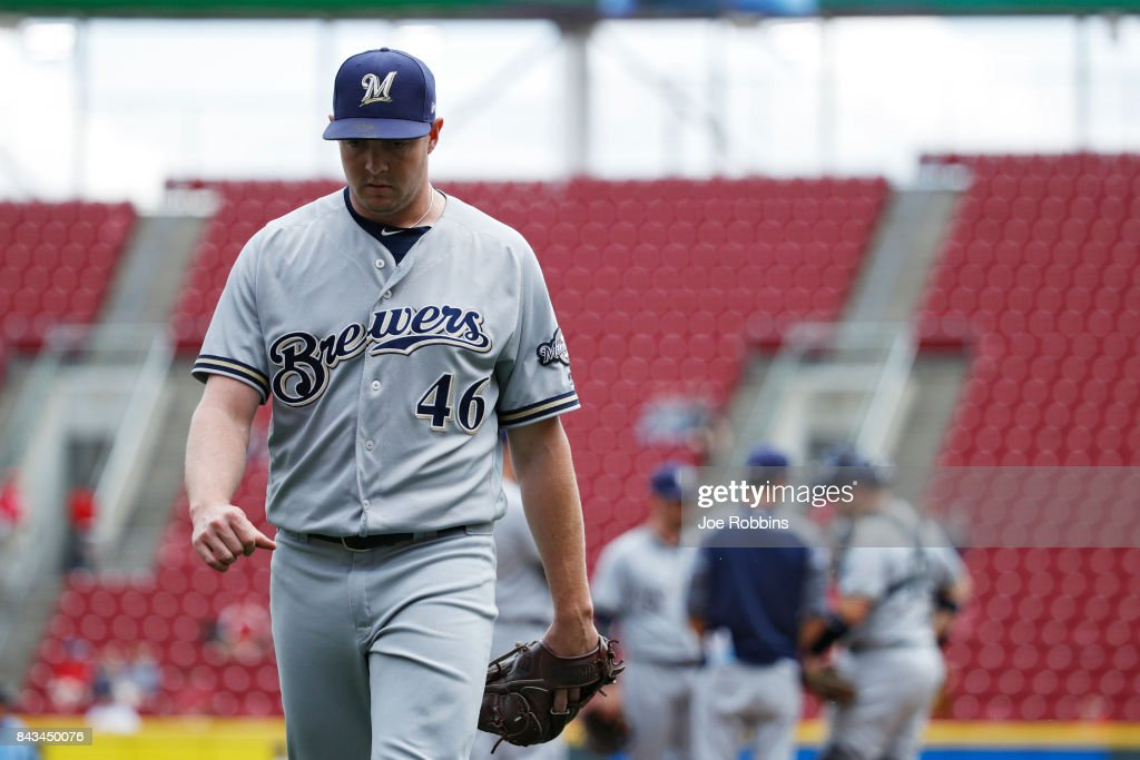 Corey Knebel #46 of the Milwaukee Brewers walks back to the dugout after giving up a home run to Jose Peraza of the Cincinnati Reds in the eighth inning of a game at Great American Ball Park on September 6, 2017 in Cincinnati, Ohio. The Reds defeated the Brewers 7-1.