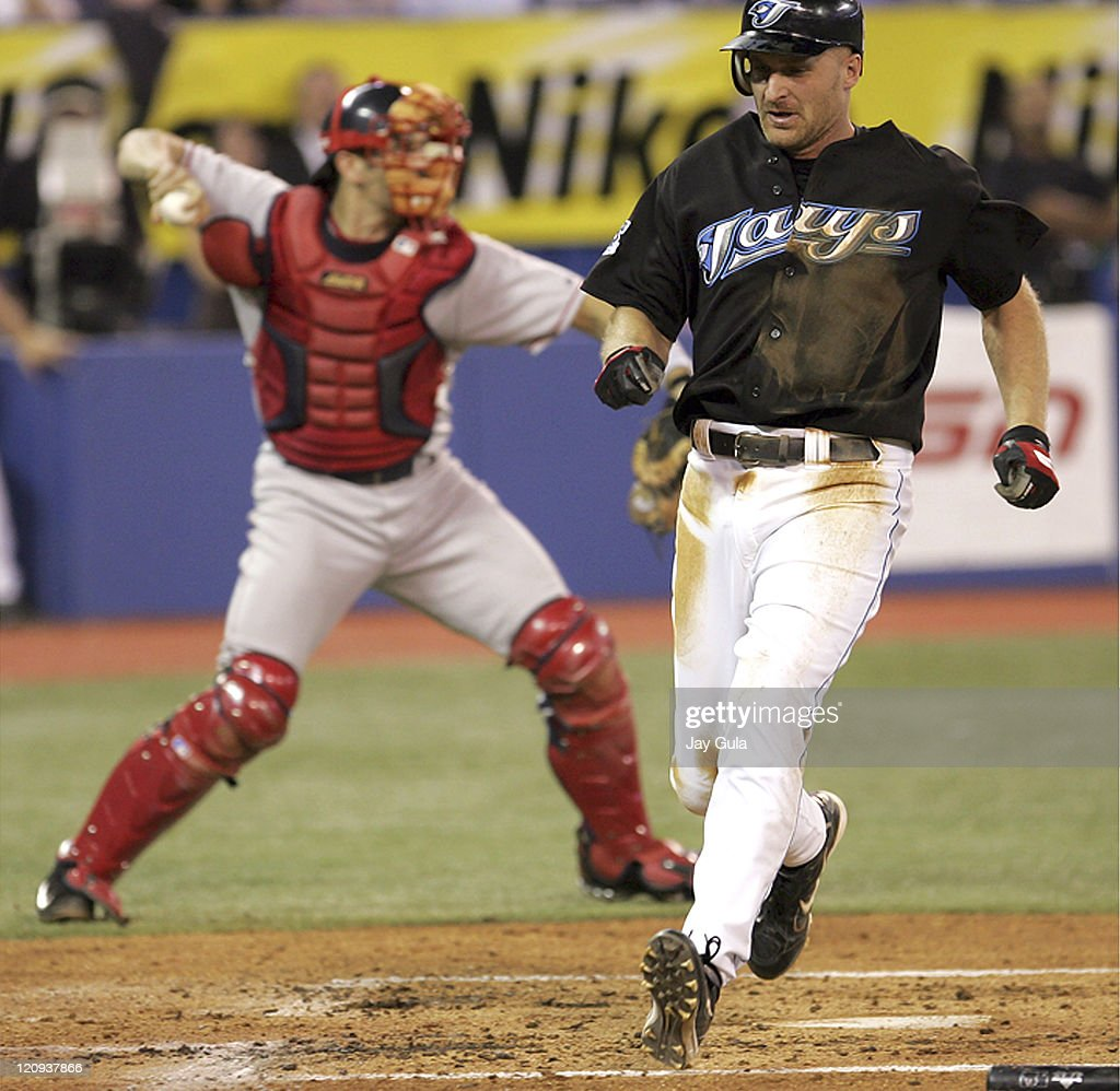 Corey Koskie scores the Blue Jays 2nd run as C Jason Varitek throws to 2nd base to try and get Shea Hillenbrand in game between the Boston Red Sox vs the Toronto Blue Jays at Rogers Centre in Toronto. September 14, 2005