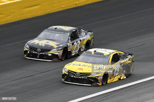 Corey LaJoie BK Racing Dr Pepper Toyota Camry races to the outside of Daniel Suarez Joe Gibbs Racing STANLEY Toyota Camry as they come out of turn...