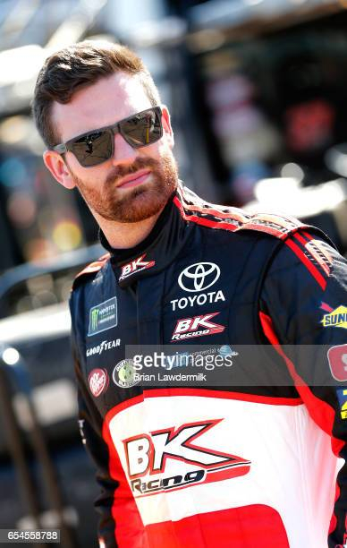 Corey LaJoie driver of the BK Racing Graphics Toyota stands in the garage during practice for the Monster Energy NASCAR Cup Series Camping World 500...