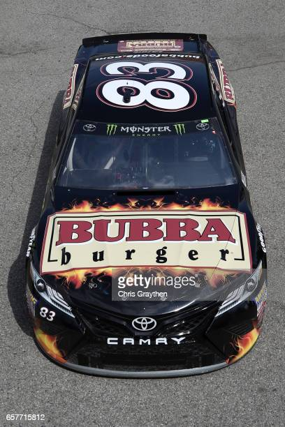 Corey LaJoie driver of the Bubba Burger Toyota drives during practice for the Monster Energy NASCAR Cup Series Auto Club 400 at Auto Club Speedway on...