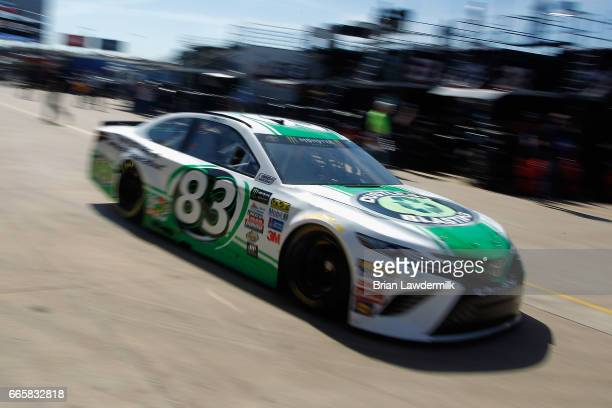 Corey LaJoie driver of the Dustless Blasting Toyota drives through the garage area during practice for the Monster Energy NASCAR Cup Series O'Reilly...