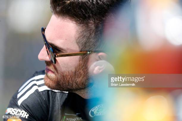 Corey LaJoie driver of the Dustless Blasting Toyota stands on the grid during qualifying for the Monster Energy NASCAR Cup Series GEICO 500 at...