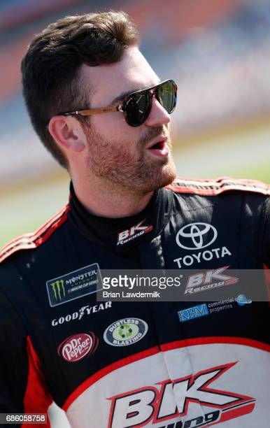 Corey LaJoie driver of the Hope for the Warriors Toyota stands by his car during the Monster Energy NASCAR Open Qualifying at Charlotte Motor...