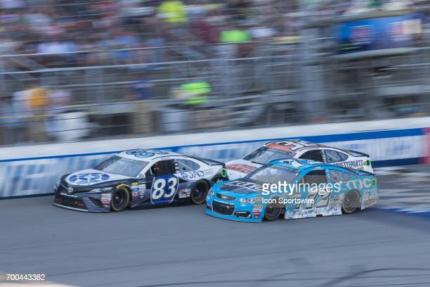 Corey LaJoie driver of the JAS Expedited Trucking Toyota and Cole Whitt driver of the RTIC Coolers Chevrolet race during the Monster Energy Cup...