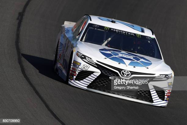 Corey LaJoie driver of the JAS Expedited Trucking Toyota practices for the Monster Energy NASCAR Cup Series Pure Michigan 400 at Michigan...