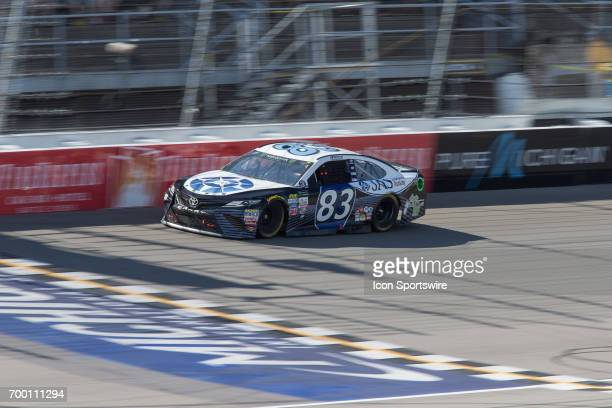Corey LaJoie driver of the JAS Expedited Trucking Toyota races during the Monster Energy Cup Series Firekeepers Casino 400 race on June 18 2017 at...