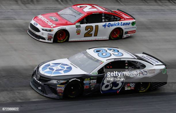 Corey LaJoie driver of the JAS Expedited Trucking Toyota races Ryan Blaney driver of the Motorcraft/Quick Lane Tire Auto Center Ford during the...