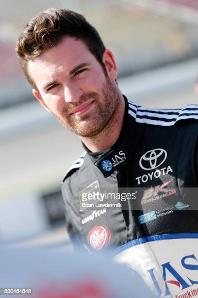 Corey LaJoie driver of the JAS Expedited Trucking Toyota walks on the grid during qualifying for the Monster Energy NASCAR Cup Series Pure Michigan...