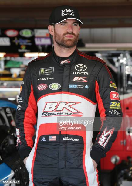 Corey LaJoie driver of the RMC Events Toyota looks on from the garage during practice for the Monster Energy NASCAR Cup Series STP 500 at...