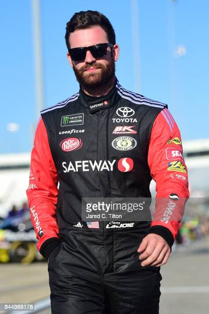 Corey LaJoie driver of the Safeway/LaBella Hair Design Toyota stands on the grid during qualifying for the Monster Energy NASCAR Cup Series Federated...