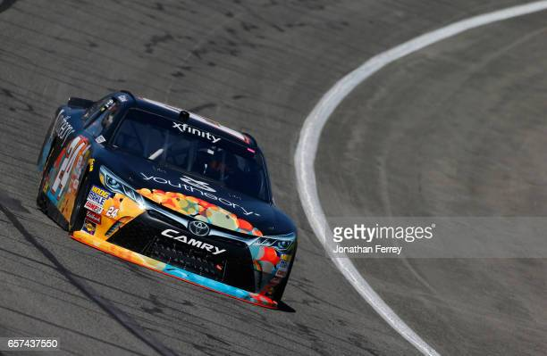 Corey LaJoie driver of the Youtheory Toyota drives during practice for the NASCAR XFINITY Series Service King 300 at Auto Club Speedway on March 24...