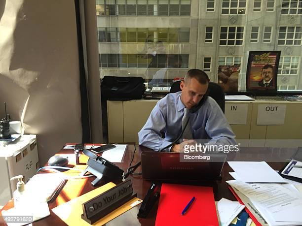 Corey Lewandowski campaign manager for Donald Trump's 2016 Republican presidential campaign speaks on the telephone while at his desk inside the...