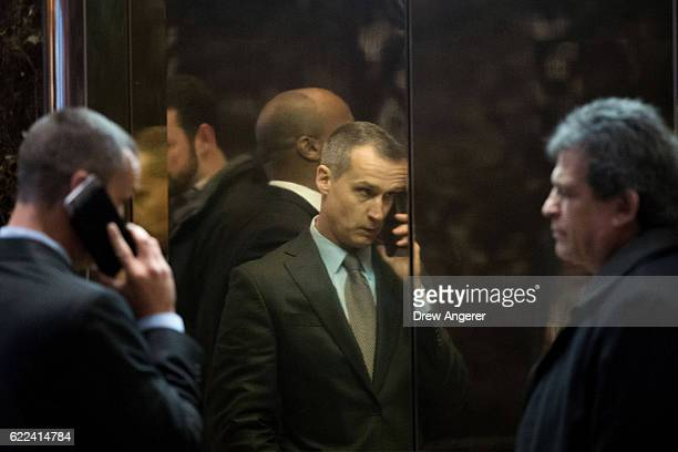 Corey Lewandowski former campaign manager for Donald Trump is reflected on a wall as he walks into an elevator in the lobby of Trump Tower November...