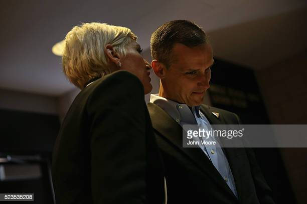 Corey Lewandowski the campaign manager for Republican Presidential frontrunner Donald Trump consults with staff backstage at a campaign rally on...