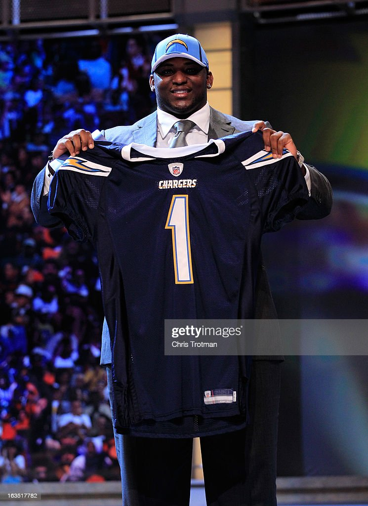 <a gi-track='captionPersonalityLinkClicked' href=/galleries/search?phrase=Corey+Liuget&family=editorial&specificpeople=5533751 ng-click='$event.stopPropagation()'>Corey Liuget</a>, #18 overall pick by the San Diego Chargers, holds up a jersey on stage during the 2011 NFL Draft at Radio City Music Hall on April 28, 2011 in New York City.