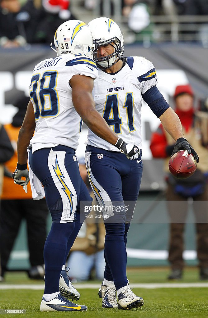 <a gi-track='captionPersonalityLinkClicked' href=/galleries/search?phrase=Corey+Lynch&family=editorial&specificpeople=5313171 ng-click='$event.stopPropagation()'>Corey Lynch</a> #41 of the San Diego Chargers is congratulated by teammate <a gi-track='captionPersonalityLinkClicked' href=/galleries/search?phrase=Marcus+Gilchrist&family=editorial&specificpeople=6250197 ng-click='$event.stopPropagation()'>Marcus Gilchrist</a> #38 after intercepting a pass from quarterback Greg McElroy #14 of the New York Jets during the second half at MetLife Stadium on December 23, 2012 in East Rutherford, New Jersey. The Chargers defeated the Jets 27-17.