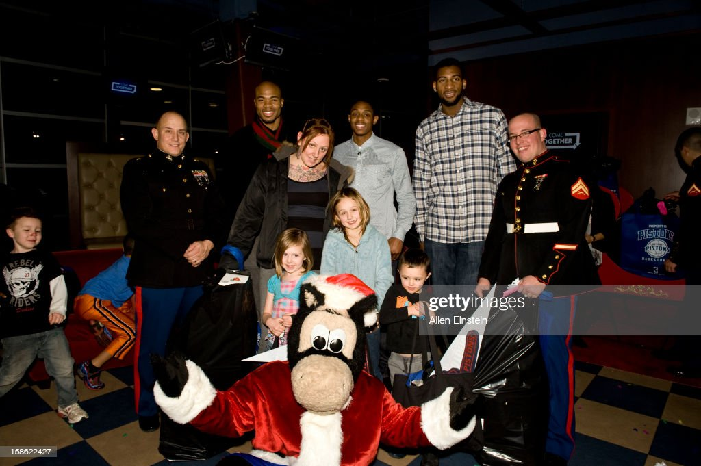 Corey Maggette, Brandon Knight, and Andre Drummond of the Detroit Pistons, their mascot Hooper, and U.S. Marines pass out holiday presents during the Detroit Pistons Toys for Tots Holiday event for metro Detroit families at the Palace of Auburn Hills on December 20, 2012 in Auburn Hills, Michigan. User expressly acknowledges and agrees that, by downloading and/or using this Photograph, user is consenting to the terms and conditions of the Getty Images License Agreement. Mandatory Copyright Notice: Copyright 2012 NBAE