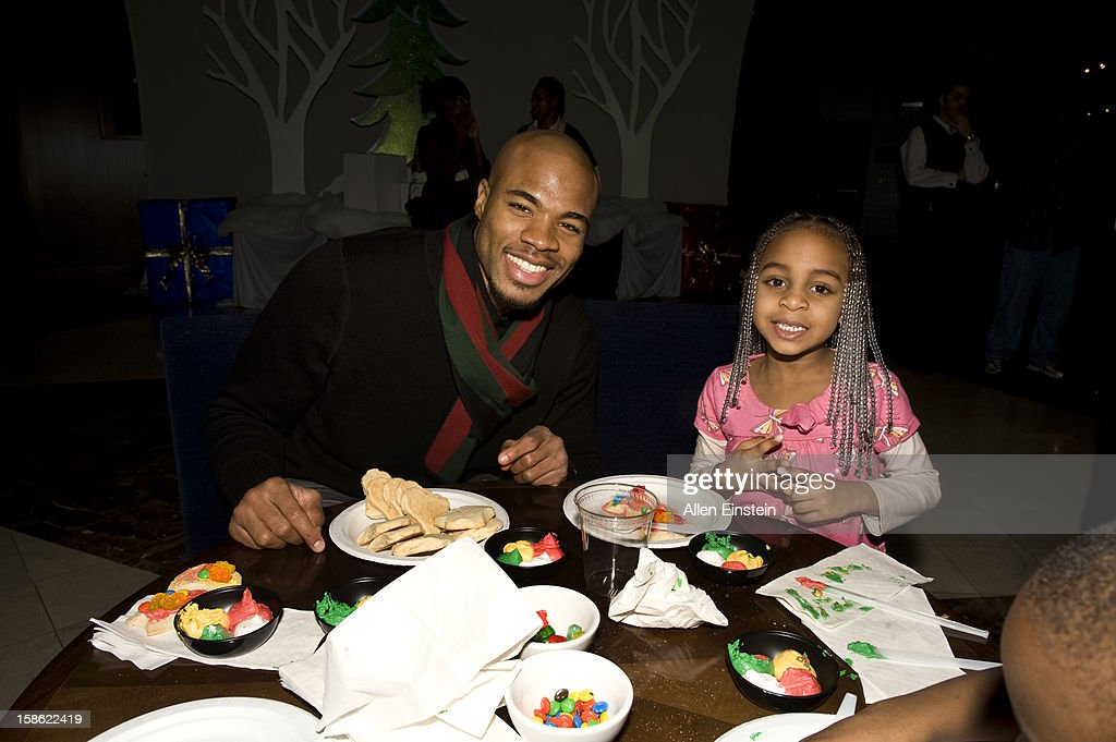 Corey Maggette of the Detroit Pistons and a young friend show off their newly decorated cookie during the Detroit Pistons Toys for Tots Holiday event for metro Detroit families at the Palace of Auburn Hills on December 20, 2012 in Auburn Hills, Michigan. User expressly acknowledges and agrees that, by downloading and/or using this Photograph, user is consenting to the terms and conditions of the Getty Images License Agreement. Mandatory Copyright Notice: Copyright 2012 NBAE