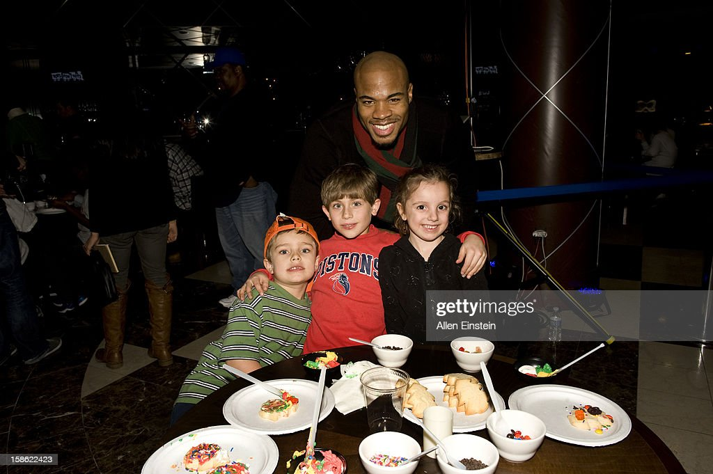 Corey Maggette of the Detroit Pistons and his young friends show off their cookie decorating skills during the Detroit Pistons Toys for Tots Holiday event for metro Detroit families at the Palace of Auburn Hills on December 20, 2012 in Auburn Hills, Michigan. User expressly acknowledges and agrees that, by downloading and/or using this Photograph, user is consenting to the terms and conditions of the Getty Images License Agreement. Mandatory Copyright Notice: Copyright 2012 NBAE