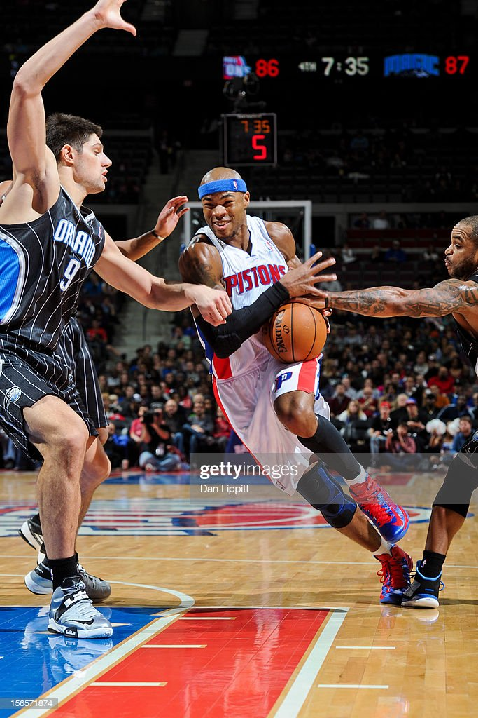 Corey Maggette #50 of the Detroit Pistons drives against Jameer Nelson #14 and Nikola Vucevic #9 of the Orlando Magic on November 16, 2012 at The Palace of Auburn Hills in Auburn Hills, Michigan.