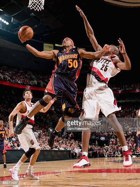 Corey Maggette of the Golden State Warriors hooks a shot against Travis Outlaw of the Portland Trail Blazers during the preseason game on October 8...