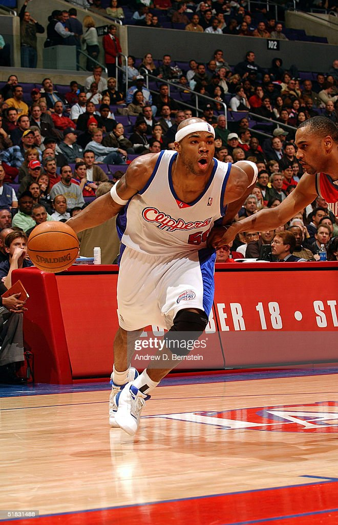 Corey Maggette of the Los Angeles Clippers drives to the hoop against Steve Smith of the Charlotte Bobcats on December 6 2004 at the Staples Center...