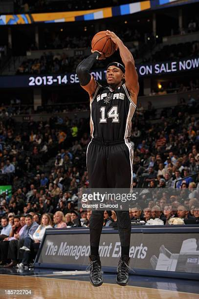Corey Maggette of the San Antonio Spurs shoots during the game against the Denver Nuggets on October 14 2013 at the Pepsi Center in Denver Colorado...