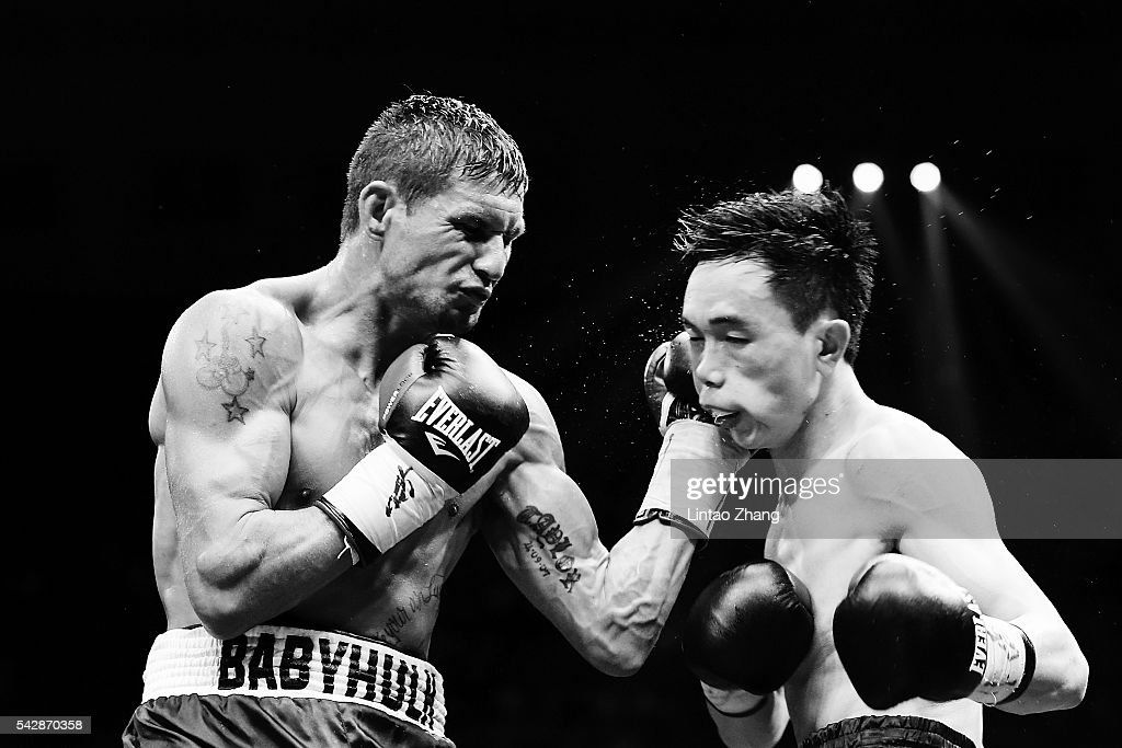 Corey McConnell of Australia delivers a punch toXu Can of China during their WBA Super Featherweight Title battle match at Capital Indoor Stadium on June 24, 2016 in Beijing, China.