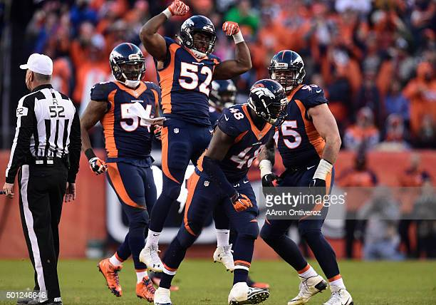 Corey Nelson Brandon Marshall Derek Wolfe and Shaquil Barrett of the Denver Broncos celebrate Barrett's sack in the third quarter The Broncos played...