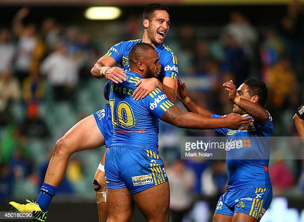 Corey Norman and Chris Sandow of the Eels celebrate a try by team mate Junior Paulo during the round 13 NRL match between the Parramatta Eels and the...
