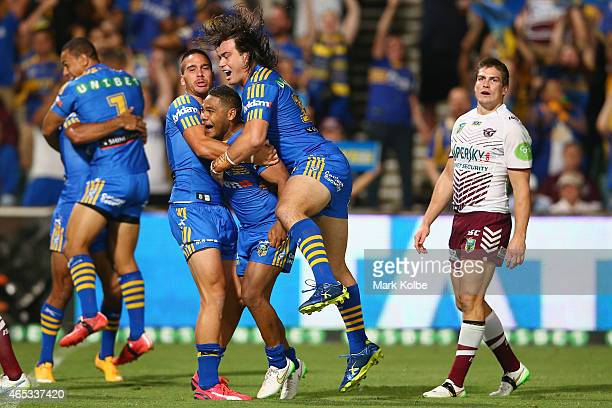 Corey Norman Chris Sandow and Tepai Moeroa of the Eels celebrate after Sandow scored a try during the round one NRL match between the Parramatta Eels...
