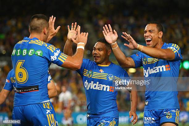 Corey Norman Chris Sandow and Will Hopoate of the Eels celebrate after an Eels try during the round one NRL match between the Parramatta Eels and the...
