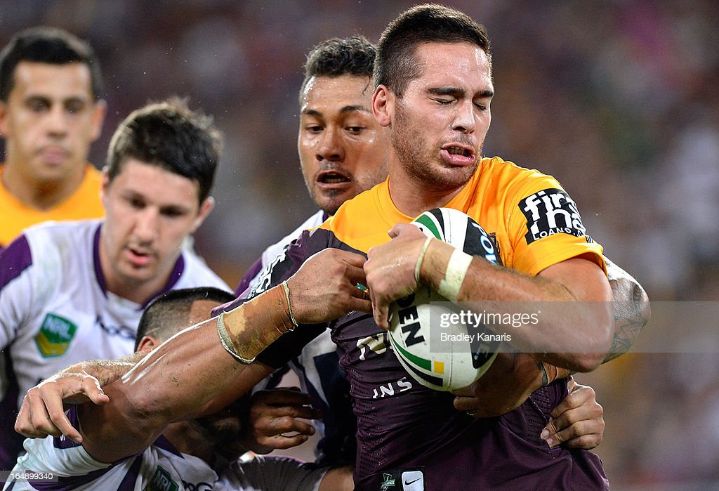Corey Norman of the Broncos attempts to break away from the defence during the round four NRL match between the Brisbane Broncos and the Melbourne Storm at Suncorp Stadium on March 29, 2013 in Brisbane, Australia.