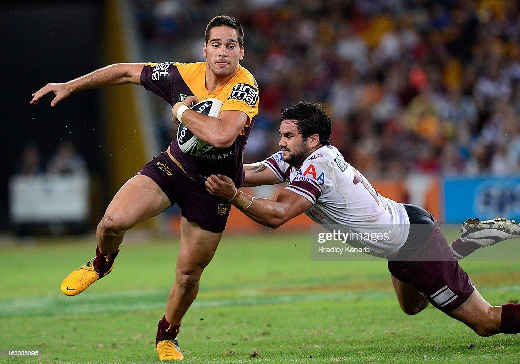Corey Norman of the Broncos attempts to break free from the defence during the round one NRL match between the Brisbane Broncos and the Manly Warringah Sea Eagles at Suncorp Stadium on March 8, 2013 in Brisbane, Australia.