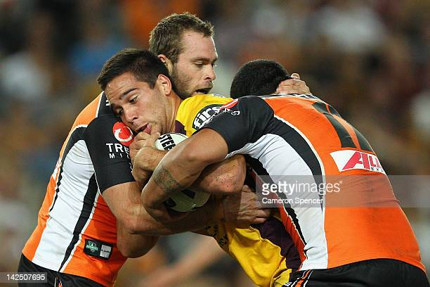 Corey Norman of the Broncos is tackled during the round six NRL match between the Wests Tigers and the Brisbane Broncos at Allianz Stadium on April 6...