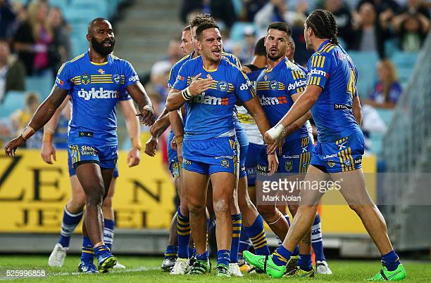 Corey Norman of the Eels celebrates a his try with team mates during the round nine NRL match between the Parramatta Eels and the Canterbury Bulldogs...