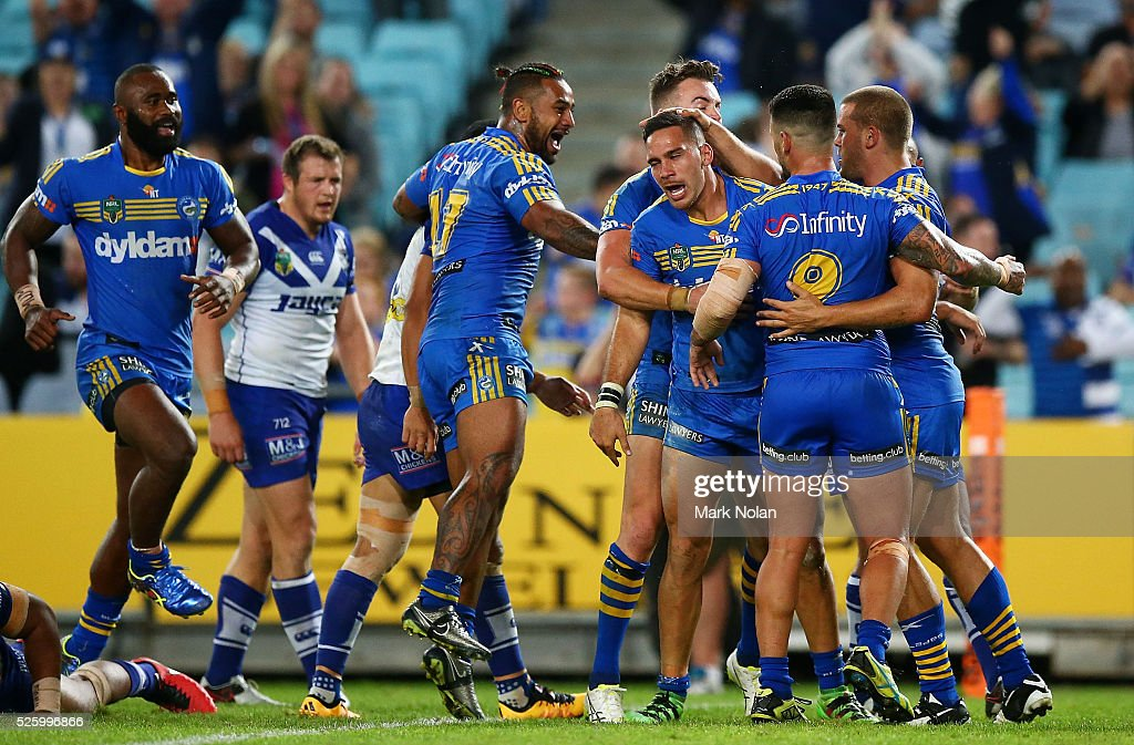 Corey Norman of the Eels celebrates a his try with team mates during the round nine NRL match between the Parramatta Eels and the Canterbury Bulldogs at ANZ Stadium on April 29, 2016 in Sydney, Australia.