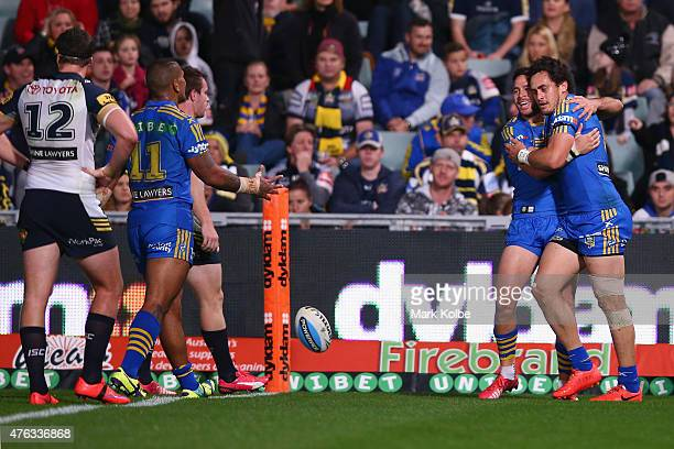Corey Norman of the Eels celebrates with Brad Takairangi of the Eels after he scored a try during the round 13 NRL match between the Parramatta Eels...