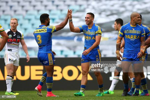 Corey Norman of the Eels celebrates with team mates after scoring a try during the round eight NRL match between the Parramatta Eels and the Penrith...
