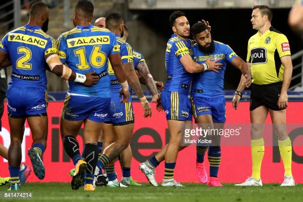 Corey Norman of the Eels congratulates team mate Michael Jennings of the Eels after scoring a try during the round 26 NRL match between the...