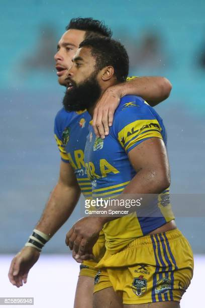 Corey Norman of the Eels embraces team mate Michael Jennings during the round 22 NRL match between the Canterbury Bulldogs and the Parramatta Eels at...