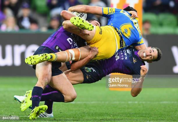 Corey Norman of the Eels is tackled by Billy Slater of the Storm during the NRL Qualifying Final match between the Melbourne Storm and the Parramatta...