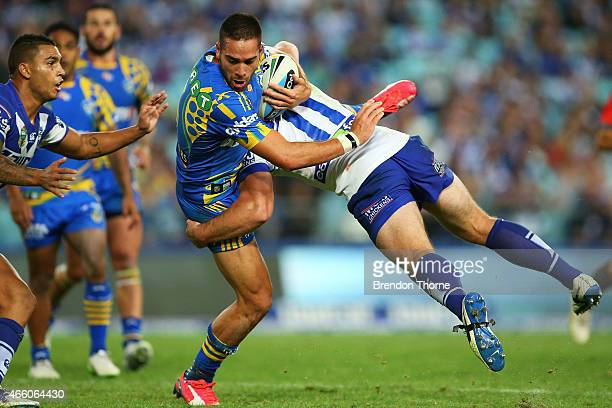 Corey Norman of the Eels is tackled by Josh Jackson of the Bulldogs during the round two NRL match between the Canterbury Bulldogs and the Parramatta...